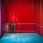Red Shirt in Big Red Elevator